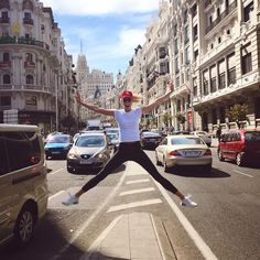 Karlie Kloss jumps for joy during her trip to Spain.