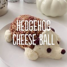 Add a smile to your appetizer spread with this adorable cheese ball! The combination of cheeses creates such a creamy, delicious spread that would be perfect with some crackers, grapes and figs.