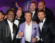 """CANNES, FRANCE - MAY 18: (L to R) Wesley Snipes, Jason Statham, Sylvester Stallone, Glen Powell, director Patrick Hughes and Kellan Lutz attend """"The Expendables 3"""" private dinner and party at Gotha Night Club at Palm Beach on May 18, 2014 in Cannes, France. (Photo by David M. Benett/Getty Images for Millennium Films)"""