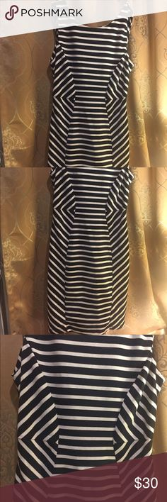 Bisou Bisou Showstopping Dress is calling you Black & cream striped with v shape back drop and diamond cut out. Polyester & Spandex.  Stretches.  So sad to part with - fits to snug on me.  Happy for you who it goes to! Bisou Bisou Dresses Midi