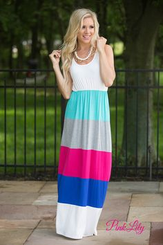 This gorgeous colorblock maxi perfectly brings the colors of a summer sunrise to your closet! Featuring navy, teal, coral, white, and grey stripes paired with a coral tank-style bodice, it's a sensational color combination that you'll get many compliments for rocking! The dress also has two inch straps, an elastic waistband, and soft fabric that will make this an all-day favorite!