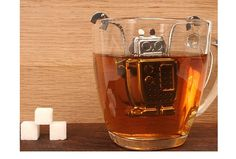 The robot shaped stainless steel tea infuser has adjustable arms to fit any size mug.