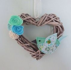 Wooden heart hanging decoration - a unique wedding or anniversary gift. This heart shaped wicker wreath is adorned with hand cut and hand sewn felt flowers and a pretty bird and suspended from ribbon, would be a beautiful addition to your home…Or if you can bear to give it away- a thoughtful mother's day gift or birthday present. This is a lovely way to freshen your spring decor. **ABOUT THIS ITEM**  *The bird is made from a carefully selected mix of fabrics and felt and finished with button…