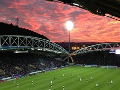 Under blood red skies at Huddersfield Town football stadium