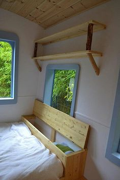 big fan of behind the headboard/couch storage, re. Amazing 5 Micro Guest House Design Ideas : Modern White Blue And Wooden Hornby Island Caravans Tiny House Bedroom Window Design Tiny House Bedroom, Tiny House Living, Home Bedroom, Bedroom Ideas, Bedrooms, Home Design, Design Ideas, Tiny House Storage, Blanket Storage