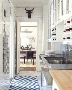great small kitchen, and the high gloss white subway tile add's light & reflection to make the space feel bigger.