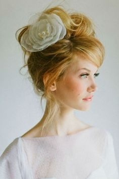 Gorgeous, slightly messy wedding hair - I wouldn't have the hair piece there, but its a pretty style