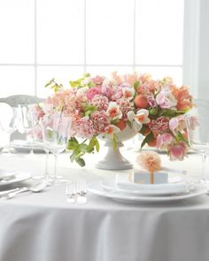 create volume on the table with using a compote - the perfect vessel for a large arrangement #wedding