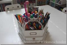 C o a H says: In the center of our desk is this super cool Making Memories Caddy was one of my old scrapbooking items. I dumped out the supplies and filled it with markers. Yep, you know you're a homeschooler when you start sacrificing your scrapbooking supplies in the name of school