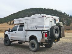 Aluminum Off Road Rear Bumper with Tire Carrier and Four-Wheel Camper on a Ford Super Duty Truck