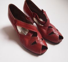 1930's cherry red leather peep toe heels with punched leather detail and criss cross elasticated strap by Russell and Bromleys, size 5. £38.00, via Etsy.