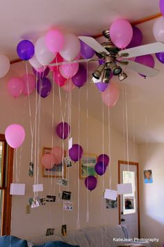 I got this idea off pinterest. We did it for my Grandma's 80th birthday and it was so cool! She was happy to see all her old pictures. It worked very well! But it was EXTREMELY humid out that day so the balloons didn't stay in the air very long, but otherwise it was a success! Love the idea!