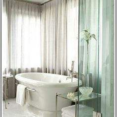 Exotic Black And White Bathroom Curtains For Windows & Awesome some Marmer Bathtub Completed With Warm , Cold Faucets & Cute Towel Rack Besides Bathtub