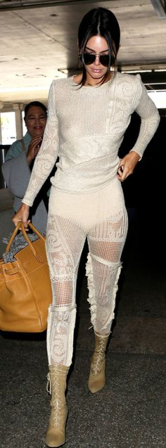 Who made  Kendall Jenner's knit top, lace pants, lace up tan boots, and brown tote handbag?