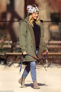 Sienna Miller dons a quirky hat while walking her pooch in New York #dailymail
