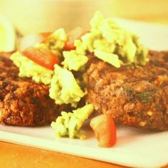 Black Bean Cakes With Guacamole | The Kind Life (sub raw beans, and flax, sesame, rice bread crumb mixture)