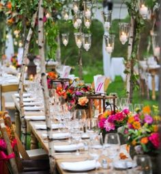 Outdoor table, with fairy lights and bright flowers (Image from Grass)