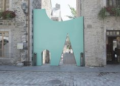 Design collective Fontaine/Fortin/Labelle has blocked both ends of a lane in Quebec's Quartier Création with a Postmodern-influenced installation of colourful walls and geometric doorways.