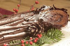Buche de Noel, or Chocolate Yule Log, is a chocolate cake filled with a flavored whipped cream, rolled and frosted with chocolate using long strokes intended to make grooves that resemble bark. There are several recipes for the buche in our archives. The recipes can be complex, the logs decorated with meringue mushrooms and other fancies, but one was simplified by Betty Crocker, this one: