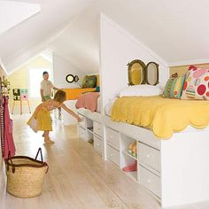 Adjoining loft beds with under-bed storage and portholes between beds. *Credit: Coastal Living.