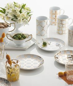 """Hostess with the Mostess! Our Luxe Moderne Appetizer Plates, made with porcelain and 24 karat gold, are the perfect serving addition to any modern table decor. Includes gift box.  Hand wash  4 assorted plates per box  Dimensions: 6"""" diameter  Made by Rosanna"""