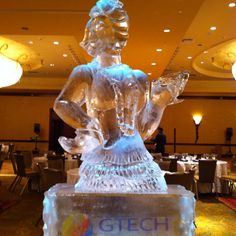 1920's Flapper girl and dress ice sculpture on top of a logo pedestal.