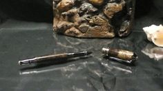The Kennedy Series Rollerball. An outstanding pen that will last a lifetime! A Burled Canxan Negro finish and Black Titanium & 22K Gold trim say it all! $145