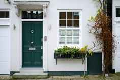 Gorgeous London Door Company door within a mews development - the colour is @INDI Interiors Farrow & Ball's Studio Green Gloss.
