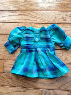 This was the most wonderful teal plaid ladies shirts that had pin tucked panels, always looking for details that upgrade -