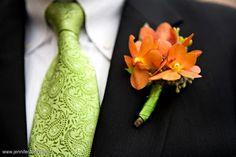 Orange mokara blooms and seeded eucalyptus in lime ribbon