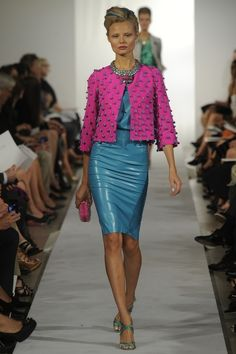 Blue leather skirt teamed with pink jacket