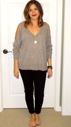 Oversized Tan Cold-Shoulder Sweater, Black Jeans, Gold Accessories, & Red Lip. Great casual fall outfit for around campus.