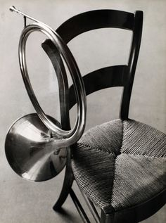 André Kertész   Chair with French Horn   1927