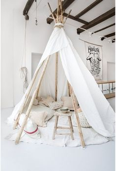 waiting tipi for our clients. light white wooden tipi of Sukha Amsterdam.