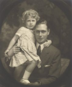 George VI, King of the United Kingdom of Great Britain with baby Elizabeth II (later Queen of the United Kingdom of Great Britain)