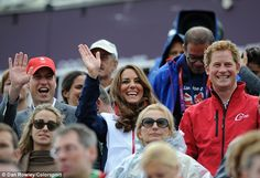 And the distinguished crowd - complete with the Duke and Duchess of Cambridge and Prince Harry - waved back