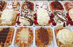 Variety of Belgian waffles on street stall in Brussels, Belgium,..