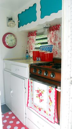 clock, polka dot serving tray, canisters, towel. love the cabinet trim.. wonder if I can install something like this in mine?