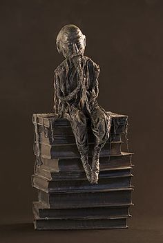 Man on Books sculpture - photo by stijnvolders, via De Effenaar