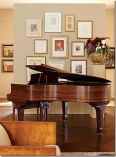 Gallery wall behind baby grand piano...This looks much like our antique baby grand....
