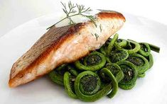 Crispy Pan-Seared Salmon with Sauteed Fiddlehead Ferns and Dill Sauce (replace butter with coconut oil, cream with low-fat yogurt)