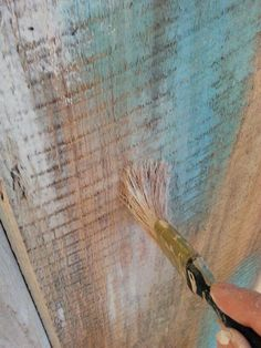 Headboard dry brushed with Turquoise and White. Painted by Patina Chic.