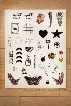 Replica One Direction temporary tattoos. I NEED THESE IN MY LIFE