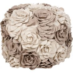 Add a lovely touch to your living room or den with this charming wool pouf, showcasing textured floral appliques in a soft taupe and beige palette.   ...