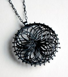 """Overlapping Cells   Necklace in oxidized sterling silver. Pendant measurs 2"""" in diameter. Chain is 30"""" in length.   Exhibit: Featured Artist: Alisa Miller   http://www.facerejewelryart.com/artist.php?id=28"""