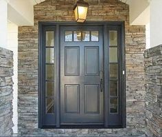 Puerta principal color cafe oscuro y piedra en contornos!!!