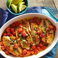 """Baked Tilapia Veracruz - """"Simple ingredients like cherry tomatoes, olives, and golden raisins combine for a colorful, low-calorie dinner."""""""