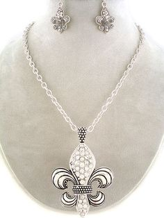 "CHUNKY 2.25"" LONG FLEUR DE LIS SILVER TONE NECKLACE SET WITH CRYSTAL ACCENTS    * If you need a necklace extender I have them for sale in my store.*      NECKLACE: 18"" LONG + 3"" EXT              HOOK EARRINGS                    COLOR: SILVER TONE          LEAD AND NICKLE FREE - 8424 - BI $19.99"