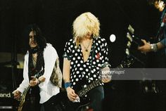 Gilby Clarke and Duff McKagan of Guns n Roses perform on stage on The Freddie Mercury Tribute Concert at Wembley Stadium on April 20th, 1992 in London, United Kingdom.