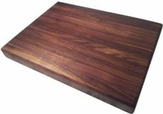 Walnut Butcher Block Cutting Board - Chopping Block - Chef's Board - Edge Grain by Armani Fine Woodworking. $148.95. Made from hand selected domestic hardwoods. Food Friendly. Handmade in Colorado, USA by Armani Fine Woodworking. Solid Walnut construction. All natural Mineral Oil & Beeswax finish. This beautiful, handmade Black Walnut Edge Grain Butcher Block Cutting Board will travel from my small shop directly to your kitchen...I'm confident that you'll love the impeccabl...
